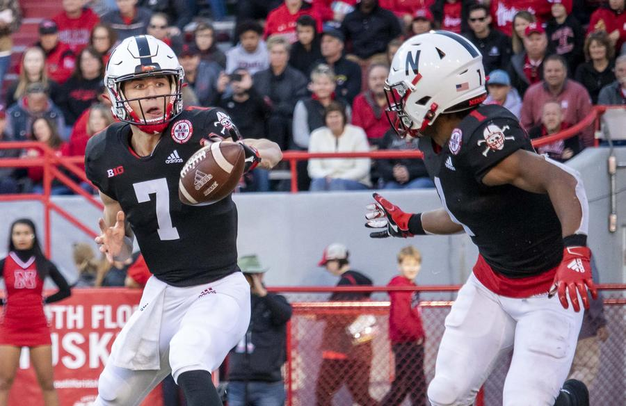 Luke McCaffrey pitches to RB Wan'Dale Robinson in the third quarter