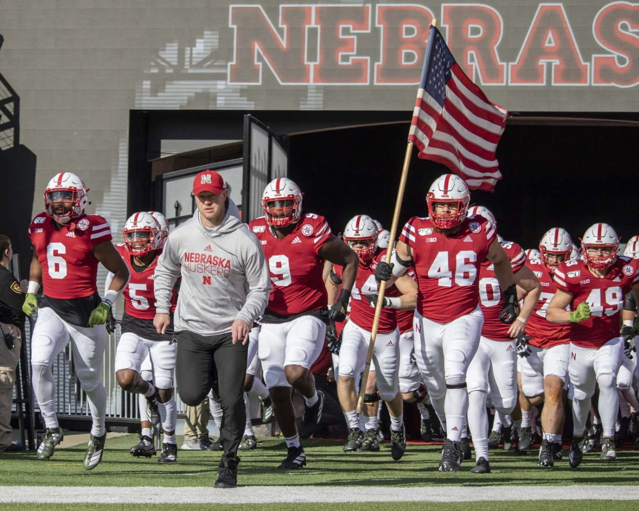 Scott Frost leads the Huskers onto the field