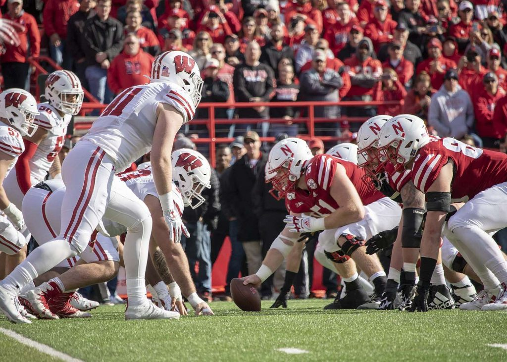 The Huskers' offensive line faces the Badgers' defense